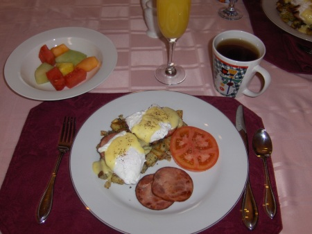 Eggs Benny, rosemary hashbrowns and Canadian bacon.  Fruit, mimosas and hot tea