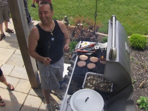 Tom BBQing burgers and Dogs