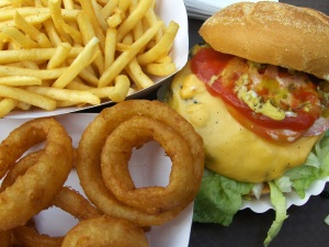 Burger, fries and onion rings at Dilly's Corner