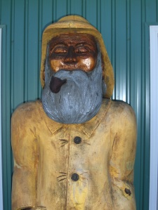 Wooden Fisherman at Fisherman's Cover Cafe on Deer Island, Canada